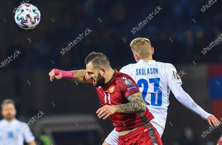 Tigran Barseghyan (C) of Armenia in action against Ari Skulason (R) of Iceland during the FIFA World Cup 2022 qualifying soccer match