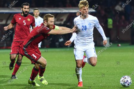 Albert Gudmundsson (R) of Iceland in action against Armenian players Artak Grigoryan (L) and Varazdat Haroyan (C) during the FIFA World Cup 2022 qualifying soccer match