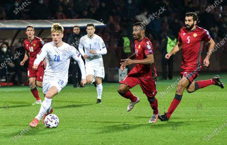 Albert Gudmundsson (2-L) of Iceland in action against Armenian players Tigran Barseghyan (2-R) and Artak Grigoryan (R)