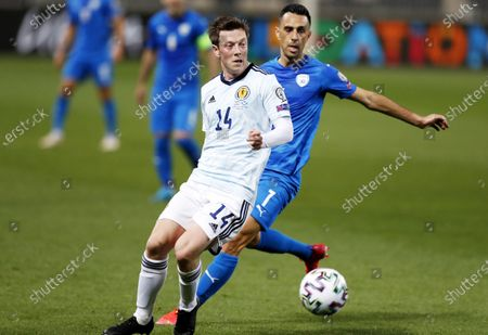 Callum McGregor (L) of Scotland in action against Eran Zahavi of Israel during the FIFA World Cup 2022 qualifying soccer match between Israel and Scotland in Tel Aviv, Israel, 28 March 2021.