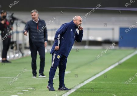 Scotland's head coach Steve Clarke watches action during a World Cup 2022 group F qualifying soccer match between Israel and Scotland in Tel Aviv, Israel