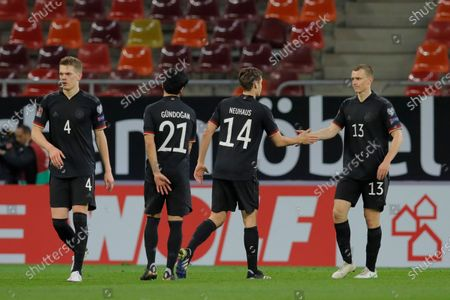 Germany's Lukas Klostermann, right, congratulates teammate Florian Neuhaus at the end of the World Cup 2022 group J qualifying soccer match between Romania and Germany at the National Arena stadium in Bucharest, Romania, . Germany won 1-0