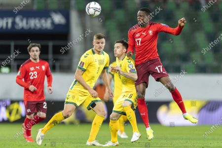 Switzerland's Denis Zakaria (R) in action agauinst Lithuanian players Tautvydas Eliosius (2-R) and Karolis Laukzemis (2-L) during the FIFA World Cup Qatar 2022 qualifying group C soccer match between Switzerland and Lithuania at the Kybunpark stadium in St. Gallen, Switzerland, 28 March 2021.