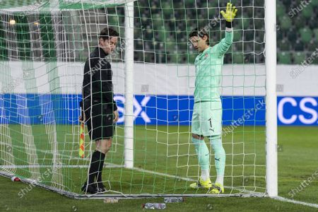 Switzerland's goalkeeper Yann Sommer (R) and a linesman (L) inspect a replacement goal after the original one was found to be deficient ahead of the FIFA World Cup Qatar 2022 qualifying Group C soccer match between Switzerland and Lithuania at the Kybunpark stadium in St. Gallen, Switzerland, 28 March 2021.