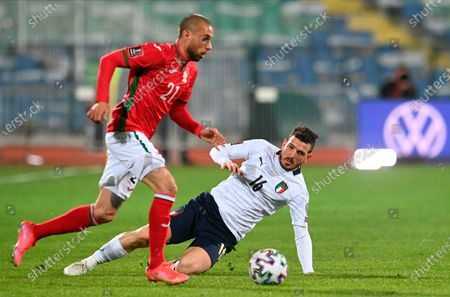 Stock Picture of Bulgaria's Momchil Tsvetanov (L) in action with Italy's Alessandro Florenzi (R) during the FIFA World Cup 2022 qualifying soccer match between Bulgaria and Italy in Sofia, Bulgaria, 28 March 2021.