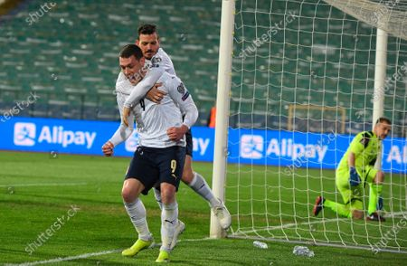 Italy's Andrea Belotti (L) celebrates with team-mate Alessandro Florenzi after scoring a penalty goal during the FIFA World Cup 2022 qualifying soccer match between Bulgaria and Italy in Sofia, Bulgaria, 28 March 2021.