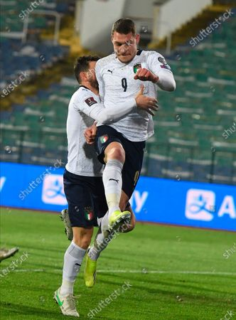 Italy's Andrea Belotti (R) celebrates with team-mate Alessandro Florenzi after scoring a penalty goal during the FIFA World Cup 2022 qualifying soccer match between Bulgaria and Italy in Sofia, Bulgaria, 28 March 2021.
