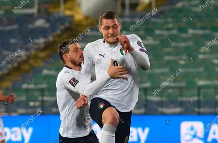Stock Image of Italy's Andrea Belotti (R) celebrates with team-mate Alessandro Florenzi after scoring a penalty goal during the FIFA World Cup 2022 qualifying soccer match between Bulgaria and Italy in Sofia, Bulgaria, 28 March 2021.