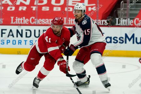 Detroit Red Wings center Luke Glendening (41) waits for the pass next to Columbus Blue Jackets defenseman Michael Del Zotto (15) during the second period of an NHL hockey game, in Detroit