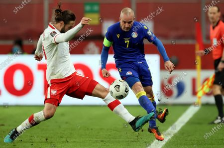 Poland's Grzegorz Krychowiak (L) in action against Andorra's Marc Pujol (R) during the FIFA World Cup Qatar 2022 qualifying group I soccer match between Poland and Andorra in Warsaw, Poland, 28 March 2021.
