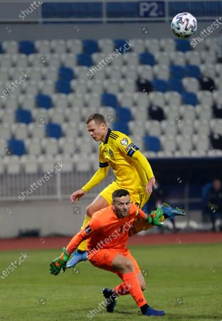 Stock Picture of Kosovo's goalkeeper Samir Ujkani, down, challenges Sweden's Viktor Claesson during the World Cup 2022 group B qualifying soccer match between Kosovo and Sweden at the Fadil Vokrri stadium in Pristina, Kosovo