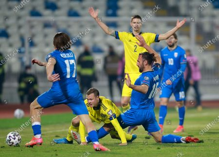 Stock Photo of Kosovo's Vedat Muriqi, right, challenges Sweden's Viktor Claesson, center down, during the World Cup 2022 group B qualifying soccer match between Kosovo and Sweden at the Fadil Vokrri stadium in Pristina, Kosovo