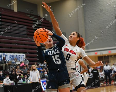 Rice forward, Lauren Schwartz (15), drives to the basket against Ole' Miss forward, Shakira Austin (0), during the Women's NIT basketball championship game between the Ole' Miss Rebels and the Rice Owls in Memphis, TN. (Photo by: Kevin Langley/CSM)