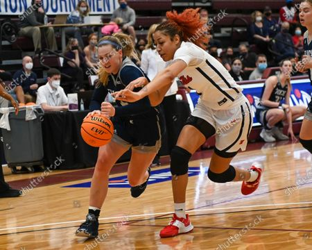 Rice forward, Lauren Schwartz (15), drives against Ole' Miss forward, Shakira Austin (0), during the Women's NIT basketball championship game between the Ole' Miss Rebels and the Rice Owls in Memphis, TN. (Photo by: Kevin Langley/CSM)