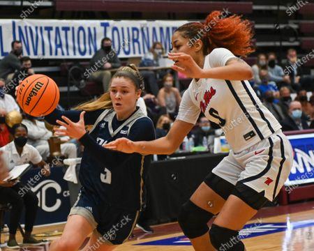 Stock Image of Rice guard, Katelyn Crosthwait (3), drives against Ole' Miss forward, Shakira Austin (0), during the Women's NIT basketball championship game between the Ole' Miss Rebels and the Rice Owls in Memphis, TN. (Photo by: Kevin Langley/CSM)