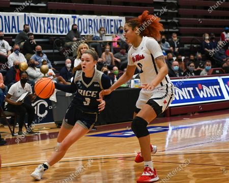 Stock Photo of Rice guard, Katelyn Crosthwait (3), drives against Ole' Miss forward, Shakira Austin (0), during the Women's NIT basketball championship game between the Ole' Miss Rebels and the Rice Owls in Memphis, TN. (Photo by: Kevin Langley/CSM)