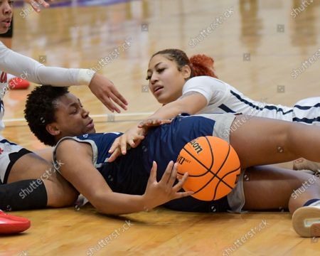 Stock Picture of Rice forward, India Bellamy (12), battles with Ole' Miss forward, Shakira Austin (0), for control of a loose ball during the Women's NIT basketball championship game between the Ole' Miss Rebels and the Rice Owls in Memphis, TN. (Photo by: Kevin Langley/CSM)