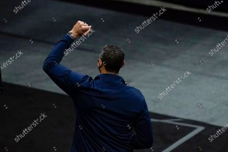 Michigan head coach Juwan Howard celebrates as he walks off the court after a Sweet 16 game against Florida State in the NCAA men's college basketball tournament at Bankers Life Fieldhouse, in Indianapolis. Michigan won 76-58