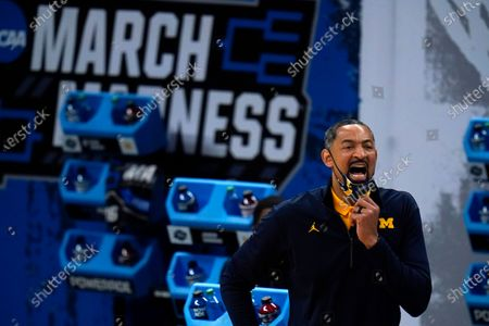 Stock Picture of Michigan head coach Juwan Howard directs his team during the first half of a Sweet 16 game against Florida State in the NCAA men's college basketball tournament at Bankers Life Fieldhouse, in Indianapolis