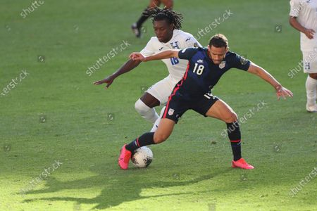 United States' Hassani Dotson(18) controls the ball challenged by Honduras' Jose Garcia during a Concacaf Men's Olympic qualifying championship semi-final soccer match in Guadalajara, Mexico
