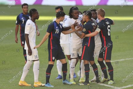 Honduras' Jose Garcia, center, and United States' Jesus Ferreira argue during a Concacaf Men's Olympic qualifying championship semi-final soccer match in Guadalajara, Mexico