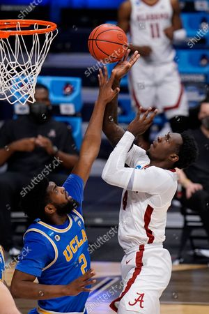 Alabama forward Juwan Gary (4) shoots on UCLA forward Cody Riley (2) in the second half of a Sweet 16 game in the NCAA men's college basketball tournament at Hinkle Fieldhouse in Indianapolis