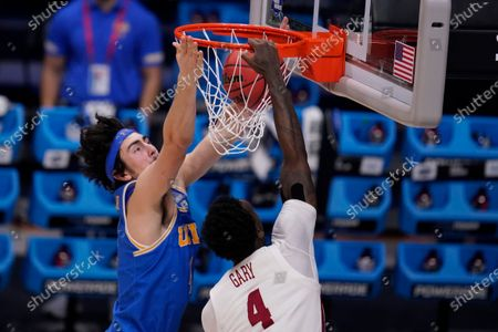 Stock Photo of Alabama forward Juwan Gary (4) dunks on UCLA guard Jaime Jaquez Jr. (4) in the first half of a Sweet 16 game in the NCAA men's college basketball tournament at Hinkle Fieldhouse in Indianapolis
