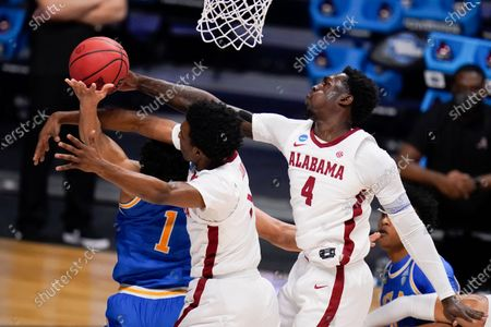 Guard Jules Bernard (1) drives to the basket as Alabama forward Herbert Jones (1) and Juwan Gary (4) defendin the first half of a Sweet 16 game in the NCAA men's college basketball tournament at Hinkle Fieldhouse in Indianapolis