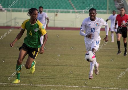 Panama's player Jose Fajardo (R) in action against Dominica's Malcolm Joseph, during a match for the Concacaf Qualifying for the Qatar 2022 World Cup, at the Felix Sanchez Stadium in Santo Domingo, Dominican Republic, 28 March 2021.