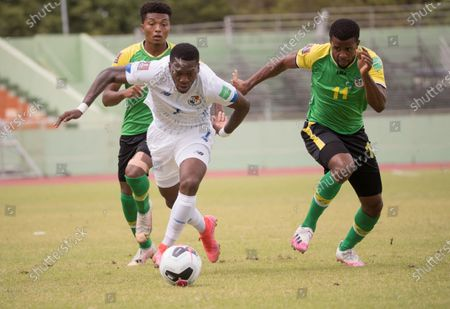 Panama's player Jose Luis Rodriguez (C) in action against Dominica's Tristón Sandy (L) and Sidney Lockhart (R), during a match for the Concacaf Qualifying for the Qatar 2022 World Cup, at the Felix Sanchez Stadium in Santo Domingo, Dominican Republic, 28 March 2021.