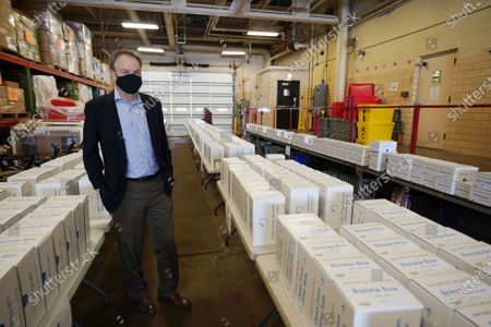 St. Louis County Executive Dr. Sam Page, looks over some of the 1,500 tablets being given away at the St. Louis County Library in Frontenac, Missouri on Sunday, March 28, 2021. The GrandPad tablet is designed to meet the needs of those over the age of 75 to access technology and stay connected to loved ones during the COVID-19 pandemic. The combined impact of social isolation and limited access to technology has been particularly difficult for older adults during the COVID-19 pandemic. The GrandPads, checked out from the library for one year to St. Louis County residents, are easy to use and were designed for use by individuals with little or no technology experience.