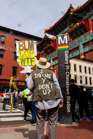 Stock Picture of Roughly 100 protesters with signs attend ANSWER Coalition's National Day of Action to Stop Anti-Asian Violence at the Chinatown Gate in downtown Washington.