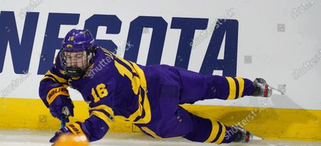 Minnesota State forward Reggie Lutz dives after the puck in the second period of an NCAA College Hockey Regional Final against Minnesota, in Loveland, Colo