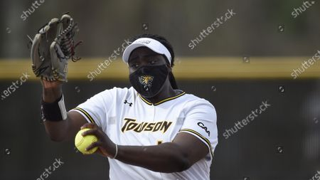 Towson pitcher Madeline Harris delivers during an NCAA softball game, in Towson, Md