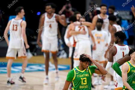 Oregon forward Chandler Lawson (13) walks off the court after a Sweet 16 game against Southern California in the NCAA men's college basketball tournament at Bankers Life Fieldhouse, in Indianapolis. Southern California won 82-68
