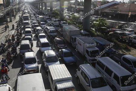 Traffic builds up at a police checkpoint set up to prevent non-essential travels by citizens at the boundary of Rizal province and Marikina City, Metro Manila, Philippines 29 March 2021. President Rodrigo Duterte ordered the Enhanced Community Quarantine (ECQ), the most restrictive type of lockdown in the country's four-level quarantine measures, during the Lenten season. Police checkpoints have been tightened at various border points in Metro Manila and nearby provinces from 29 March to 04 April.