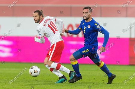 Grzegorz Krychowiak (POL) and Marc Vales (AND) during the FIFA World Cup 2022 Qatar qualifying match between Poland and Andorra on March 28, 2021 in Warsaw, Poland.