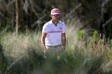 Rafa Cabrera-Bello, of Spain, walks on the ninth fairway during the third round of the Workday Championship golf tournament, in Bradenton, Fla