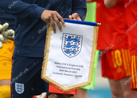 Aaron Ramsey of England Under 18s holds the match pennant before kick off