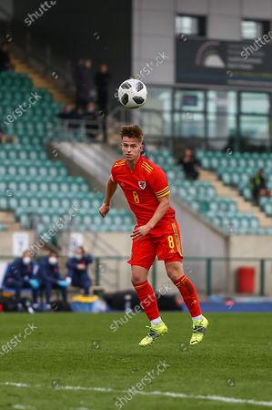 Wale's U18 Oliver Ewing (8) heads towards goal during the international friendly match between U18 Wales and U18 England at Leckwith Stadium, Cardiff