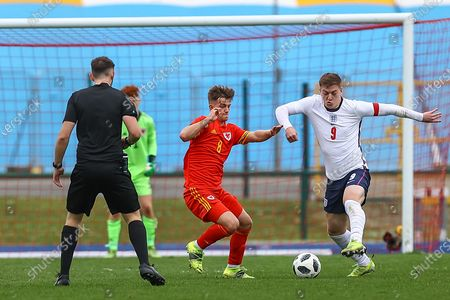 England Under 18's Liam Delap (9) under pressure from Wale's U18 Oliver Ewing (8) during the international friendly match between U18 Wales and U18 England at Leckwith Stadium, Cardiff