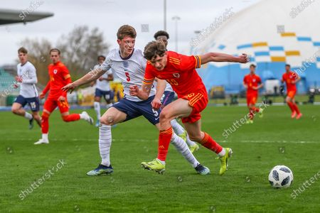 Wale's U18 Connor Salisbury (19) under pressure from England Under 18's William Fish (5) during the international friendly match between U18 Wales and U18 England at Leckwith Stadium, Cardiff