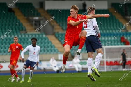 Wale's U18 Harry Jones (4) heads for goal during the international friendly match between U18 Wales and U18 England at Leckwith Stadium, Cardiff