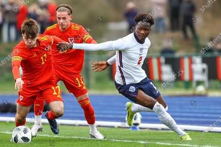 Wale's U18 Rio Dyer (17) tussles with England Under 18's Daniel Oyegoke (2) during the international friendly match between U18 Wales and U18 England at Leckwith Stadium, Cardiff