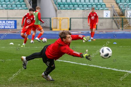 Wale's U18 substitute goalkeeper Ben Hughes (12) during the pre-match warm-up before the international friendly match between U18 Wales and U18 England at Leckwith Stadium, Cardiff