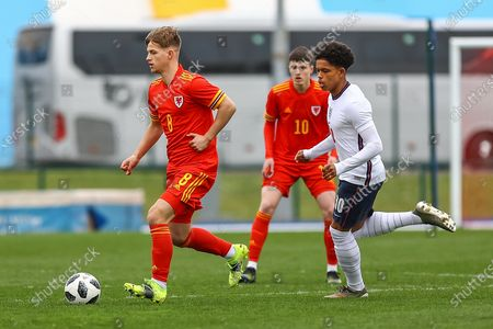 Wale's U18 Oliver Ewing (8) under pressure from England Under 18's Shola Shoretire (10) during the international friendly match between U18 Wales and U18 England at Leckwith Stadium, Cardiff