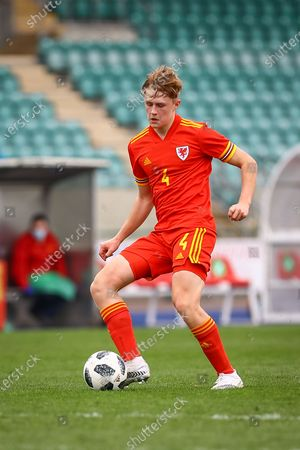 Stock Image of Wale's U18 Harry Jones (4) in action during the international friendly match between U18 Wales and U18 England at Leckwith Stadium, Cardiff