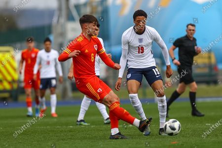 Wale's U18 Jay Williams (6) under pressure from England Under 18's Daniel Jebbison (19) during the international friendly match between U18 Wales and U18 England at Leckwith Stadium, Cardiff