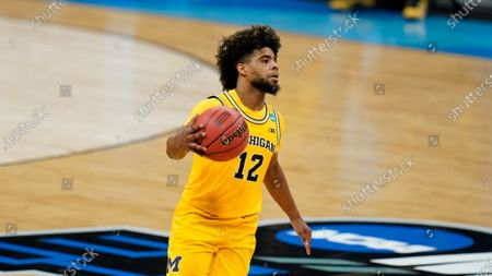 Michigan guard Mike Smith dribbles up court during a Sweet 16 game against Florida State in the NCAA men's college basketball tournament at Bankers Life Fieldhouse, in Indianapolis