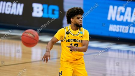 Michigan guard Mike Smith passes up court during a Sweet 16 game against Florida State in the NCAA men's college basketball tournament at Bankers Life Fieldhouse, in Indianapolis